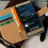 Olixar Huawei P9 Kunstledertasche Book Schwarz / Tan