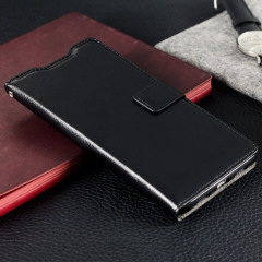 The Olixar Wallet Case in black sticks to the back of your Huawei P9 Lite to provide enclosed protection and can also be used to hold your credit cards.
