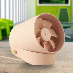 A beautifully minimalist and stylish modern smart USB powered fan in peach that features two touch sensitive quiet operating modes, contra-rotating blades and a carry handle which doubles as a stand and hanging hook for wall mounting.