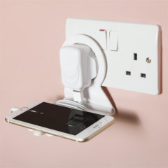 This ThumbsUp ingenious mains charging shelf allows you to charge your mobile phone conveniently by reducing the cable clutter. Place the shelf over the charger which is connected to your phone, and secure the device on a non-slip finger looking base!