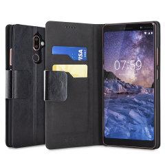 Protégez votre Nokia 7 Plus à l'aide de cette superbe housse Olixar portefeuille en simili cuir noir. Robuste et élégante, c'est une judicieuse protection pour préserver au quotidien votre smartphone. Polyvalente, elle peut se transformer en un instant en support de visionnage, vous pourrez ainsi regarder confortablement vos films et autres contenus.