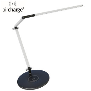 Personalise your desk space with the KONCEPT cutting-edge designer task lamp in white, utilising space better by doubling up as a super useful Qi wireless charging pad.