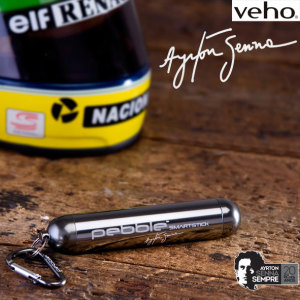 The stylish Ayrton Senna Signature Collection Pebble Smartstick+ emergency portable battery pack charger for mobile devices has been enhanced with an increased 3000mAh power supply, ergonomic re-design with protective screw on port dust cap.