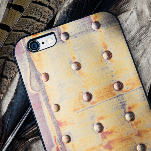 "iKins or ""innovative skins"" by Man&Wood is a range of stunningly unique designer cases for the iPhone 6S / S, made using special materials and processes. Here we have Bronze Dot, featuring a metallic effect studded design that looks amazing."