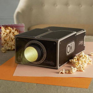 Project your smartphone videos onto the big screen with the 8x magnifying, portable and easy to assemble universal smartphone projector. Lightweight and compact the projector can be taken anywhere and stored conveniently when not in use.