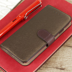 Seek sleek genuine leather protection with the golden brown Genuine Calf Leather iPhone 7 wallet case from Hansmare. Featuring integrated slots for cards and ticket, this is the perfect utility case  to keep your iPhone 7 safe and scuff-free.