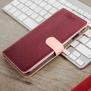 Seek sleek genuine leather protection with the wine pink Genuine Calf Leather iPhone 7 Plus wallet case from Hansmare. Featuring integrated slots for cards and ticket, this is the perfect utility case  to keep your iPhone 7 Plus safe and scuff-free.