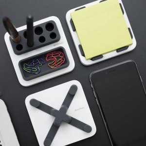 The MThings Smartphone Stand & Desktop Organiser consolidates the space on your cluttered desk, offering a holder for your phone as well as an elegant, convenient way to store office equipment like writing stationery and sticky notes.