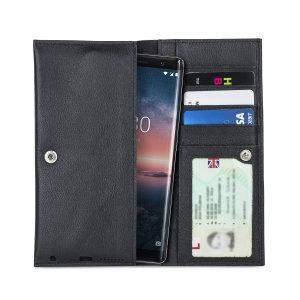 Protégez avec élégance votre Nokia 8 Sirocco à l'aide de la pochette Olixar Primo en coloris noir. Fabriquée à partir d'un cuir véritable de haute qualité et dotée d'une finition cousue avec précision, d'une fermeture à bouton sécurisée, et d'une doublure interne douce, elle assure une protection optimale à votre smartphone. Par ailleurs, elle comprend des emplacements dédiés pour vos différentes cartes ainsi que vos documents les plus importants.