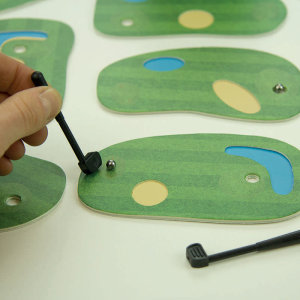 Whether you are a pro golfer or just like to play as a hobby, this miniature game is the one for you! This storage tin has been converted into a 9 hole cardboard golf course. Perfect to take along with you on your commutes to keep you occupied.