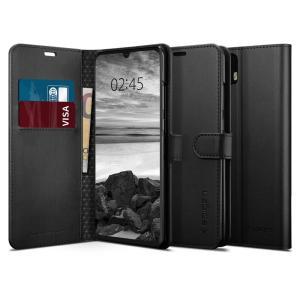 La housse Spigen Wallet S en coloris noir dispose d'une finition de haute qualité en cuir synthétique, d'emplacements dédiés au rangement de vos différentes cartes et d'un support de visualisation intégré. Une fois équipée, votre Huawei P30 Pro est intégralement protégé et dispose d'un look à la fois luxueux et professionnel.