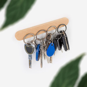 This Olixar wooden key holder organiser can easily mount on any wall and hold up to 4 sets of keys or any magnetic objects with it's adhesive sticker at the back.