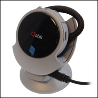 Charge the Qstik headset using the charging cradle
